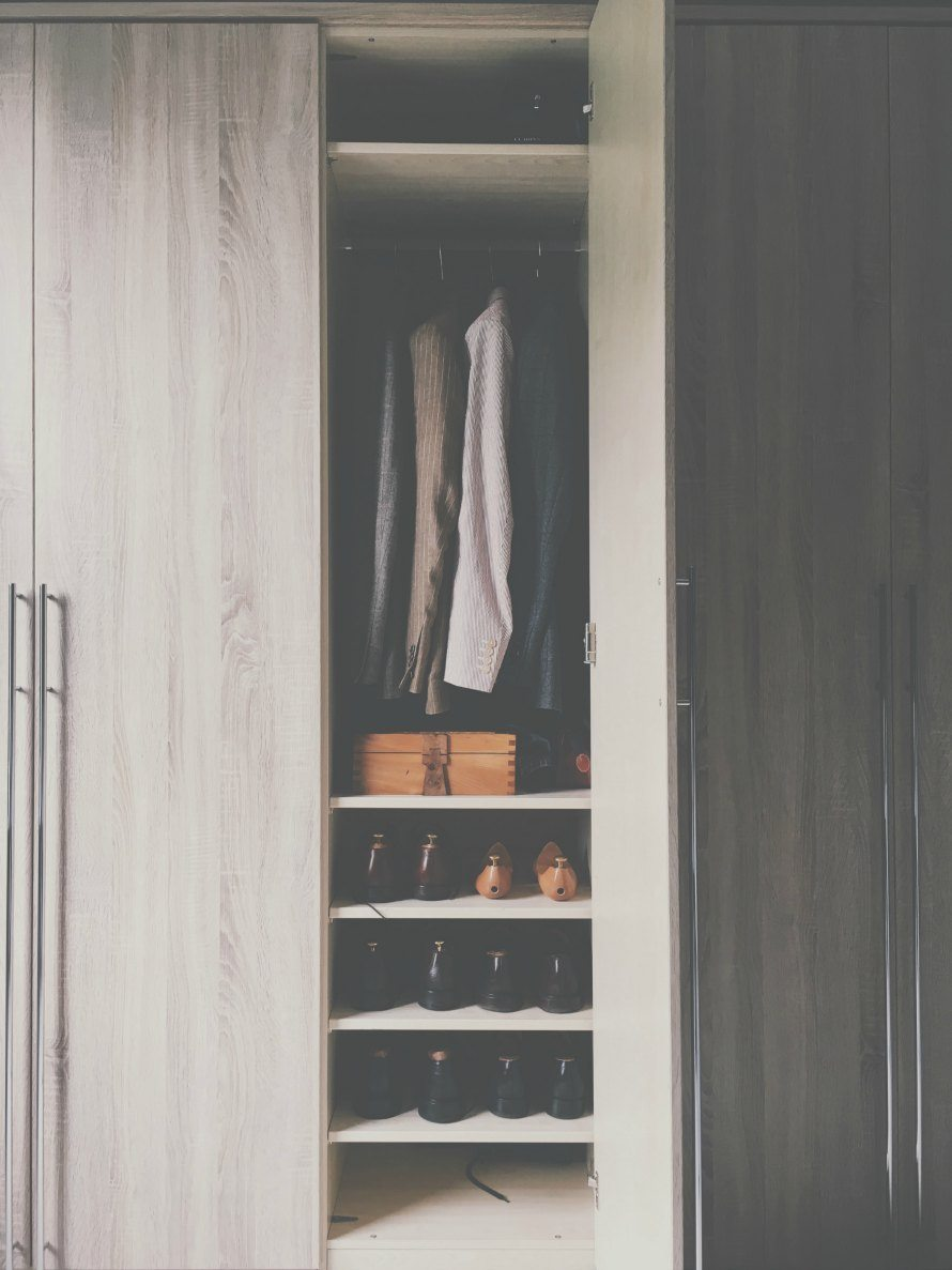 clothes organised in a wardrobe